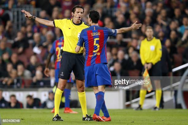 referee Deniz Aytekin Sergio Busquets of FC Barcelonaduring the UEFA Champions League round of 16 match between FC Barcelona and Paris Saint Germain...