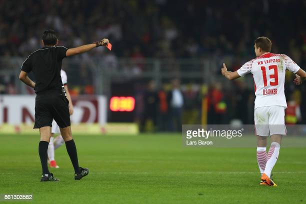 Referee Deniz Aytekin shows a red card to Stefan Ilsanker of Leipzig during the Bundesliga match between Borussia Dortmund and RB Leipzig at Signal...
