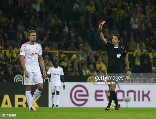 Referee Deniz Aytekin shows red card to Marcel Sabitzer of Rasenballsport Leipzig during the Bundesliga soccer match between Borussia Dortmund and...