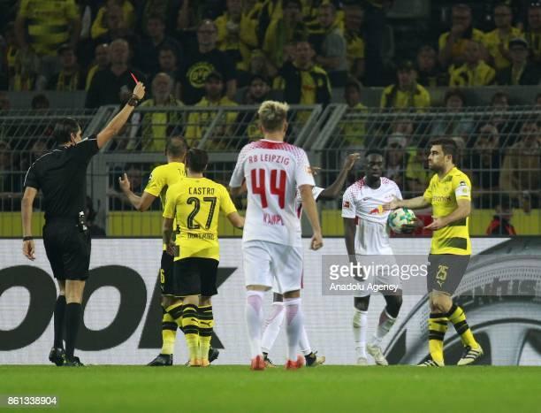 Referee Deniz Aytekin shows red card to Sokratis Papastatopulos of Borussia Dortmund during the Bundesliga soccer match between Borussia Dortmund and...