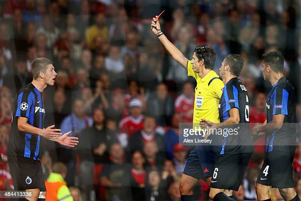 Referee Deniz Aytekin shows the red card to Brandon Mechele of Club Brugge during the UEFA Champions League Qualifying Round Play Off First Leg match...