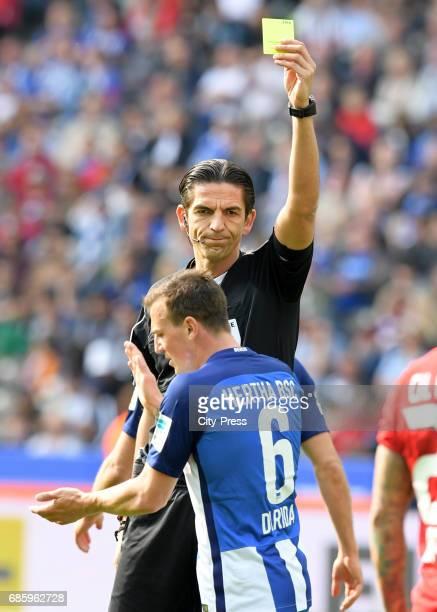 referee Deniz Aytekin shows Vladimir Darida of Hertha BSC the yellow card during the game between Hertha BSC and Bayer 04 Leverkusen on may 20 2017...