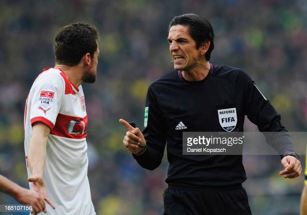 Referee Deniz Aytekin talks to Christian Gentner of Stuttgart during the Bundesliga match between VfB Stuttgart and Borussia Dortmund at MercedesBenz...