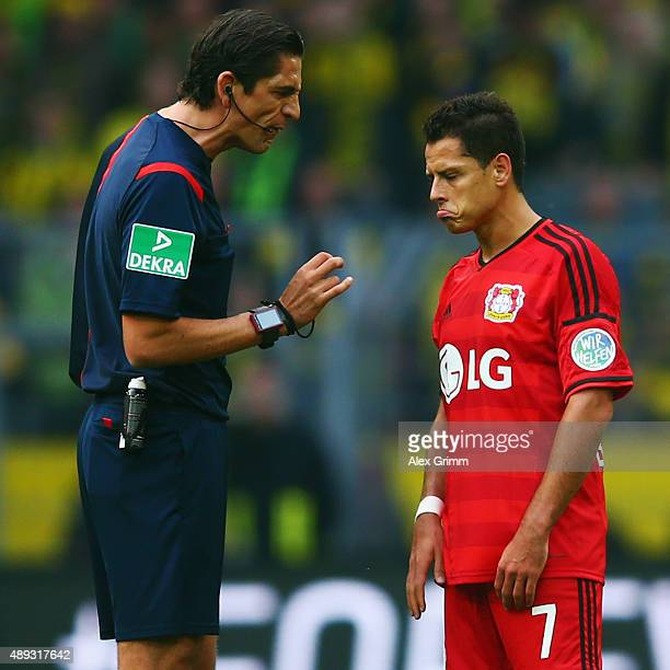 Referee Deniz Aytekin talks to Javier Hernandez of Leverkusen during the Bundesliga match between Borussia Dortmund and Bayer Leverkusen at Signal...