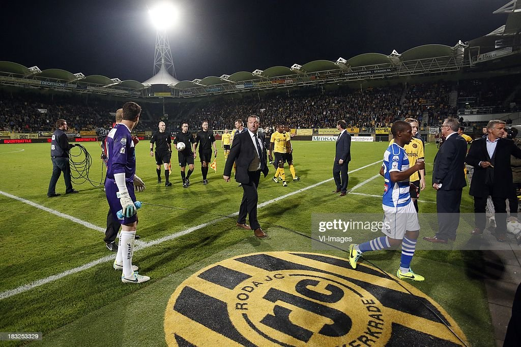 Referee Dennis Higler (5L), Coach Ron Jans of PEC Zwolle (C) during the Dutch Eredivisie match between Roda JC Kerkrade and PEC Zwolle at the Parkstad Limburg on Oktober 5, 2013 in Kerkrade, The Netherlands