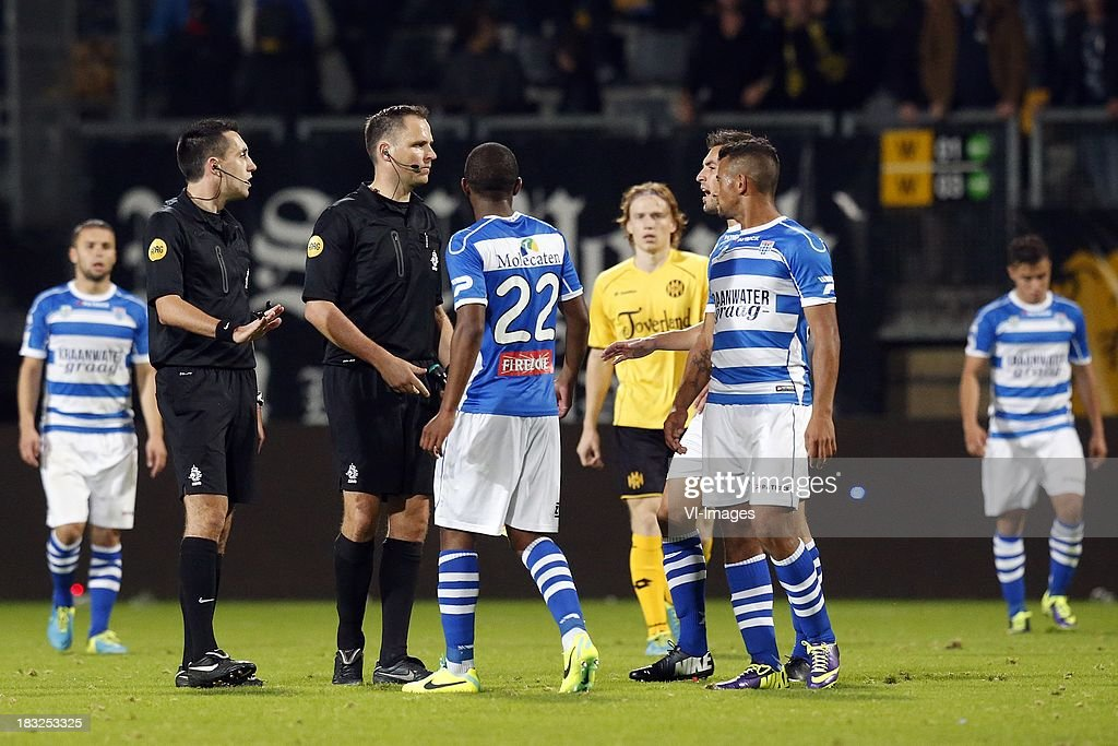 Referee Dennis Higler (L) during the Dutch Eredivisie match between Roda JC Kerkrade and PEC Zwolle at the Parkstad Limburg on Oktober 5, 2013 in Kerkrade, The Netherlands