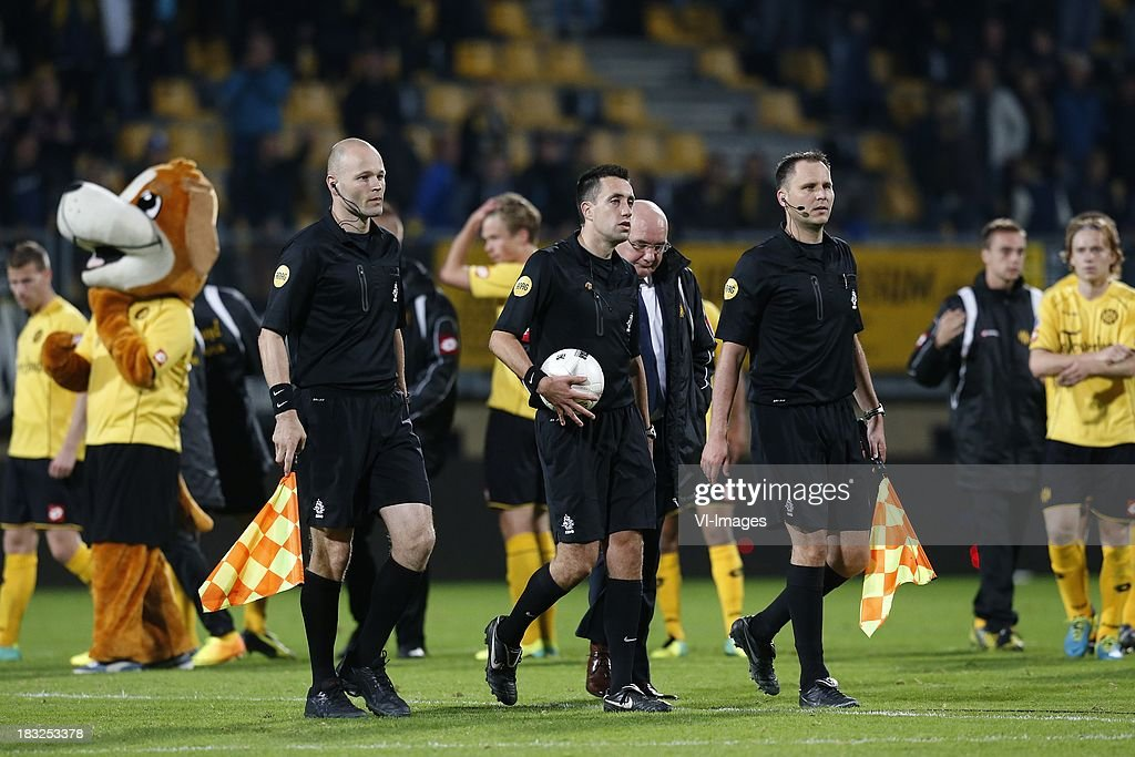 Referee Dennis Higler (C) during the Dutch Eredivisie match between Roda JC Kerkrade and PEC Zwolle at the Parkstad Limburg on Oktober 5, 2013 in Kerkrade, The Netherlands