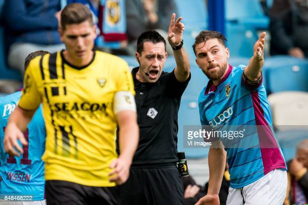 referee Dennis Higler Guram Kashia of Vitesse during the Dutch Eredivisie match between Vitesse Arnhem and VVV Venlo at Gelredome on September 17...
