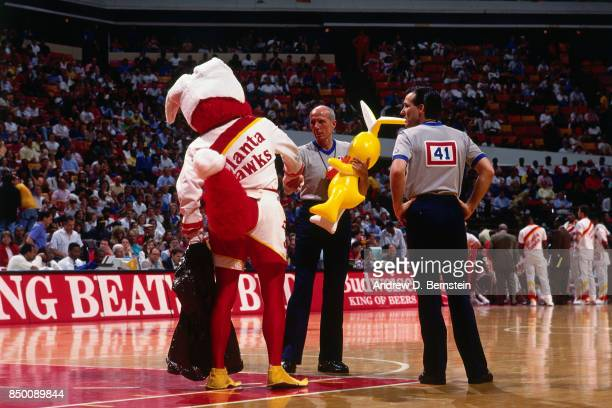 Referee Dick Bavetta shakes hands with the Atlanta Hawks mascot during a game at the Omni Coliseum in Atlanta Georgia circa 1991 NOTE TO USER User...