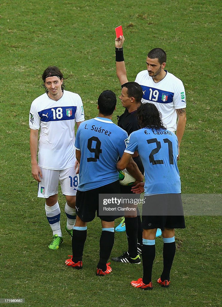 Referee Djamel Haimoud shows a red card to <a gi-track='captionPersonalityLinkClicked' href=/galleries/search?phrase=Riccardo+Montolivo&family=editorial&specificpeople=605846 ng-click='$event.stopPropagation()'>Riccardo Montolivo</a> of Italy during the FIFA Confederations Cup Brazil 2013 3rd Place match between Uruguay and Italy at Estadio Octavio Mangabeira (Arena Fonte Nova Salvador) on June 30, 2013 in Salvador, Brazil.