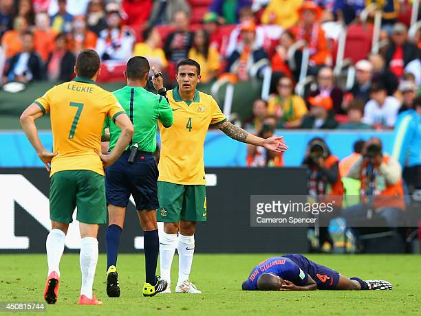 Referee Djamel Haimoudi speaks to Tim Cahill of Australia after a challenge on Bruno Martins Indi of the Netherlands resulting in a yellow card for...