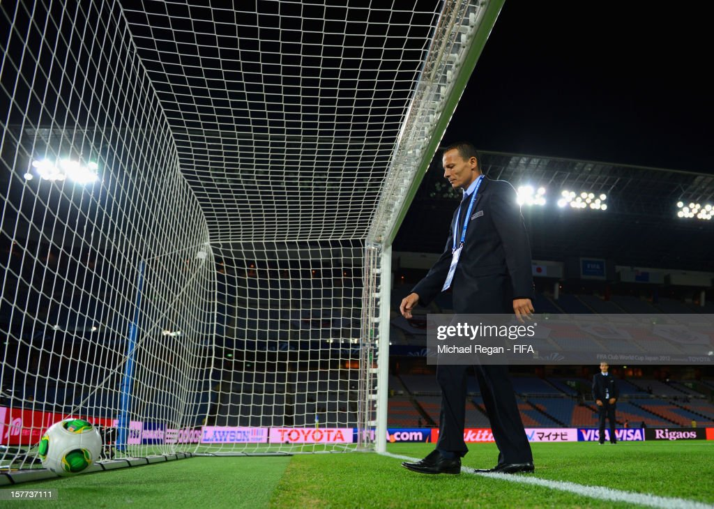 Referee Djamel Haimoudi tests the goal line technology before the FIFA Club World Cup match between Sanfrecce Hiroshima and Auckland City at International Stadium Yokohama on December 6, 2012 in Yokohama, Japan.