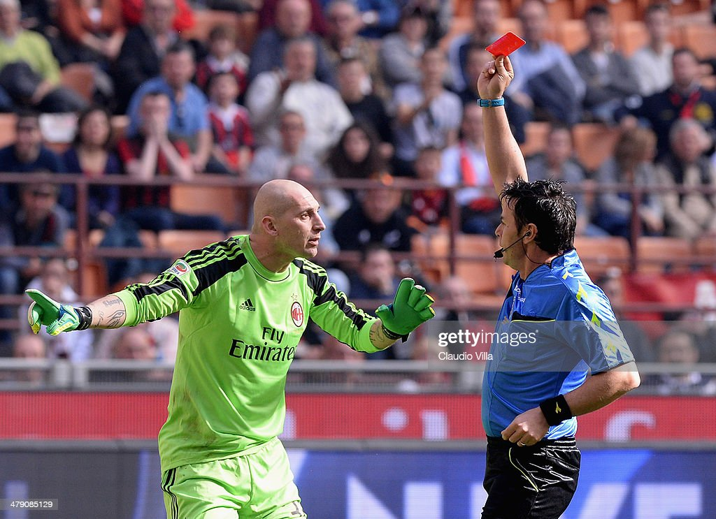 Referee Domenico Celi (R) shows the red card to <a gi-track='captionPersonalityLinkClicked' href=/galleries/search?phrase=Christian+Abbiati&family=editorial&specificpeople=2158791 ng-click='$event.stopPropagation()'>Christian Abbiati</a> of AC Milan during the Serie A match between AC Milan and Parma FC at San Siro Stadium on March 16, 2014 in Milan, Italy.