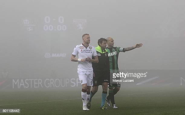 Referee Domenico Celi ÊUS Sassuolo captain Paolo Cannavaro and Torino FC captain Kamil Glik check the visibility in the field before the Serie A...