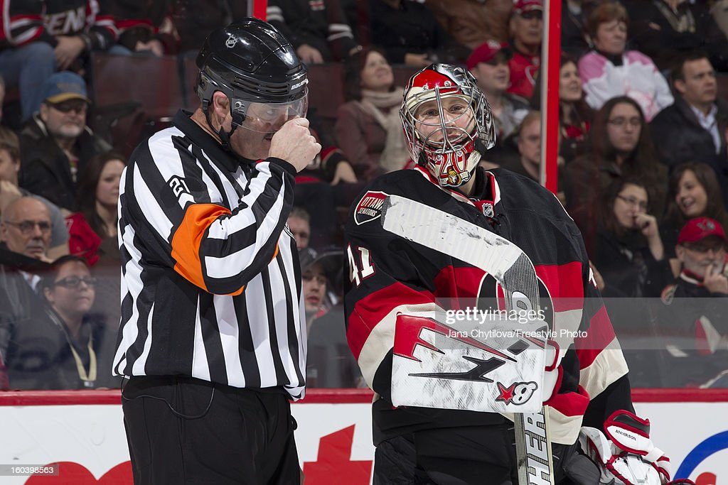 Referee Don Van Massenhoven #21 talks with Craig Anderson #41of the Ottawa Senators during an NHL game against the Washington Capitals at Scotiabank Place on January 29, 2013 in Ottawa, Ontario, Canada.