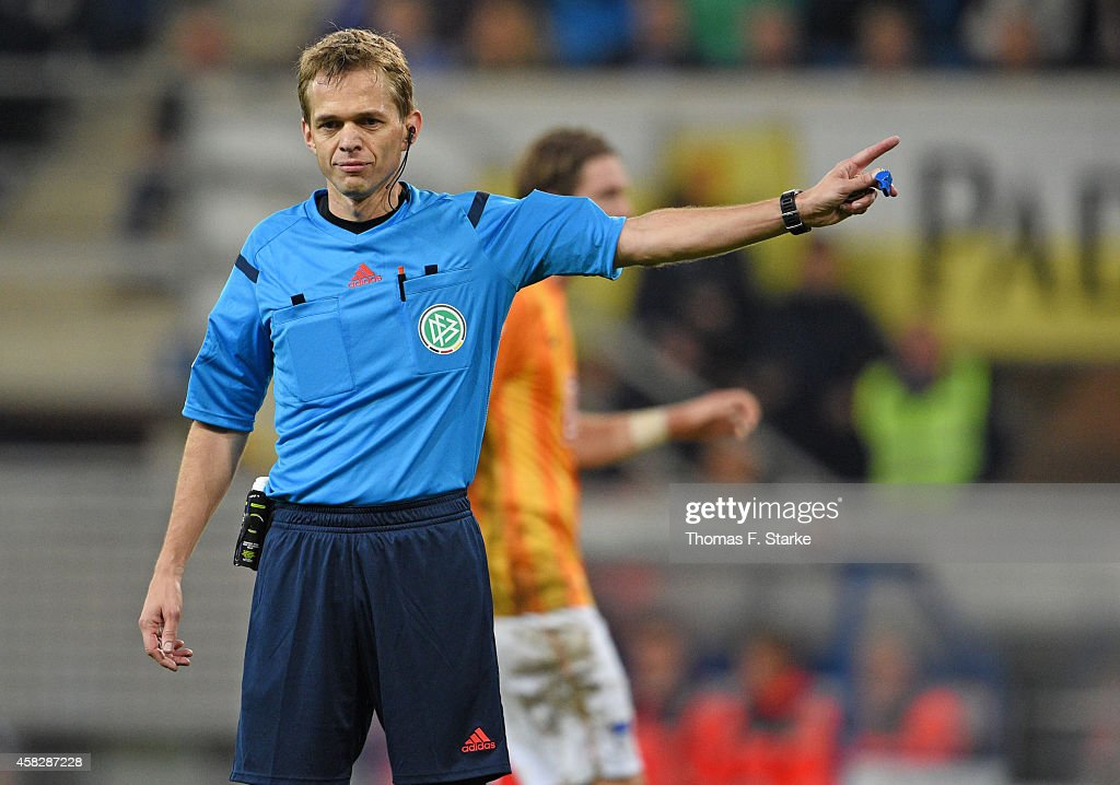 Referee Dr. <a gi-track='captionPersonalityLinkClicked' href=/galleries/search?phrase=Jochen+Drees&family=editorial&specificpeople=801383 ng-click='$event.stopPropagation()'>Jochen Drees</a> reacts during the Bundesliga match between SC Paderborn and Hertha BSC at Benteler Arena on November 2, 2014 in Paderborn, Germany.