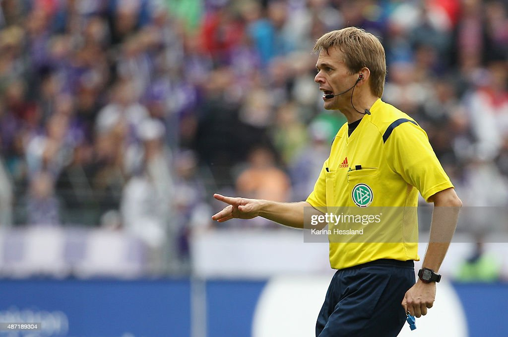 Referee Dr.<a gi-track='captionPersonalityLinkClicked' href=/galleries/search?phrase=Jochen+Drees&family=editorial&specificpeople=801383 ng-click='$event.stopPropagation()'>Jochen Drees</a> reacts during the Third League match between FC Erzgebirge Aue and Hansa Rostock at Sparkassen-Erzgebirgsstadion on September 05, 2015 in Aue, Germany.
