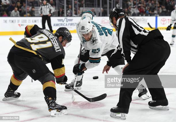 A referee drops the puck between Jonathan Marchessault of the Vegas Golden Knights and Barclay Goodrow of the San Jose Sharks for a faceoff in the...