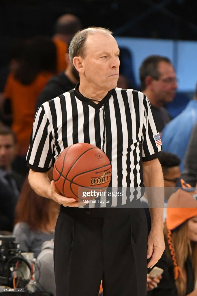 Referee Ed Corbett looks on during the Jimmy V Classic college basketball game between the Villanova Wildcats and the Syracuse Orange at Madison Square Garden on December 5, 2017 in New York City. The Orange won 72-63.