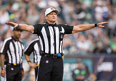 Referee Ed Hochuli calls a foul in the game between the Buffalo Bills and Philadelphia Eagles on December 13 2015 at the Lincoln Financial Field in...