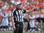 NFL referee Ed Hochuli calls a penalty as the Tampa Bay Buccaneers play against the Atlanta Falcons November 17 2013 at Raymond James Stadium in...