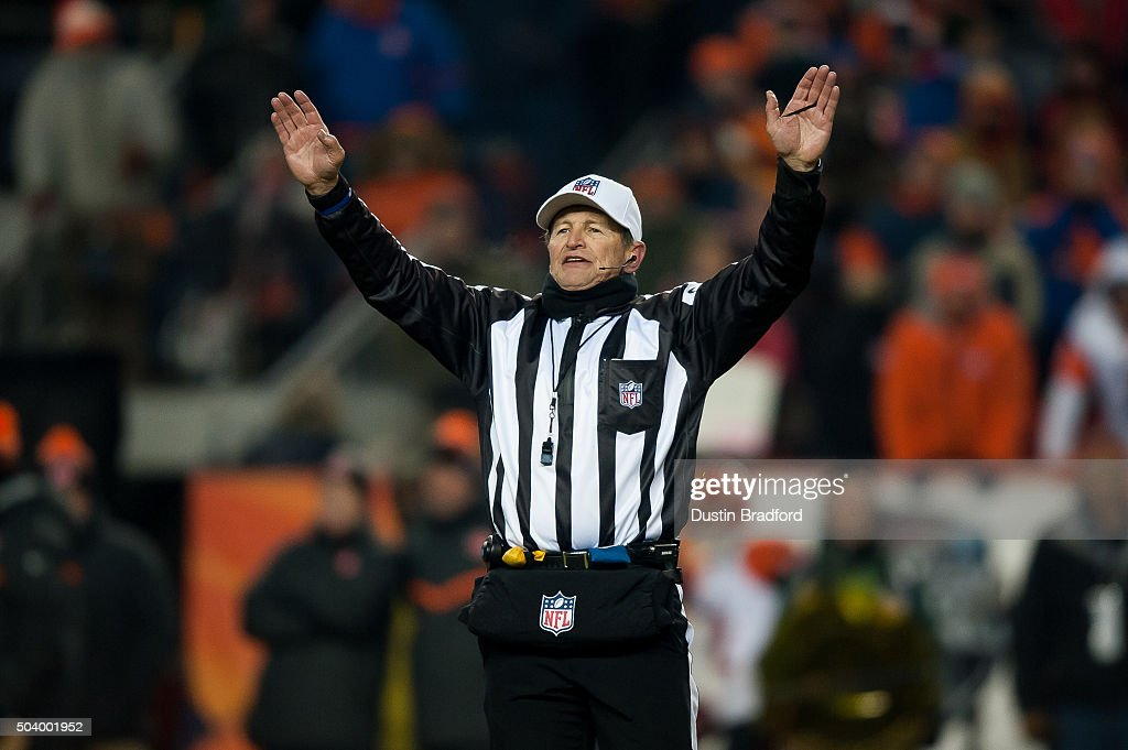 Referee <a gi-track='captionPersonalityLinkClicked' href=/galleries/search?phrase=Ed+Hochuli&family=editorial&specificpeople=2091125 ng-click='$event.stopPropagation()'>Ed Hochuli</a> #85 signals a time out during a game between the Denver Broncos and the Cincinnati Bengals at Sports Authority Field at Mile High on December 28, 2015 in Denver, Colorado.