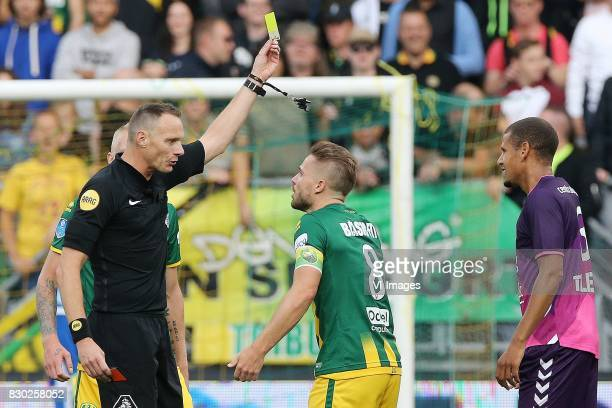 referee Ed Janssen Aaron Meijers of ADO Den Haag Ramon Leeuwin of FC Utrecht during the Dutch Eredivisie match between ADO Den Haag and FC Utrecht at...