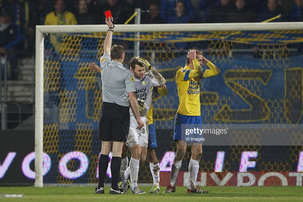 referee Ed Janssen, goalkeeper Jeroen Zoet of RKC Waalwijk, Robert Braber of RKC Waalwijk during the Dutch Eredivisie match between RKC Waalwijk and SC Heerenveen at the Mandemakers Stadium on february 1, 2013 in Waalwijk, The Netherlands