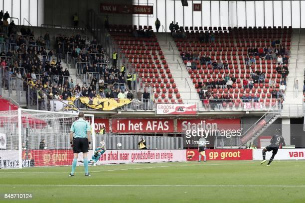 referee Ed Janssen goalkeeper Marco Bizot of AZ saves penalty Thierry Ambrose of NAC Breda during the Dutch Eredivisie match between AZ Alkmaar and...