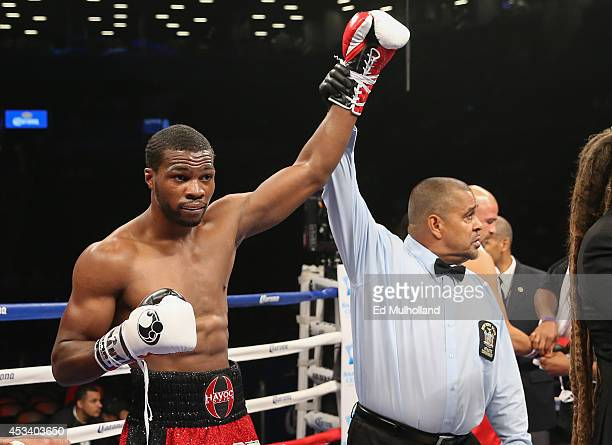 Referee Eddie Claudio raises the arm of Marcus Browne after his knockout win over Paul Vasquez at the Barclays Center on August 9 2014 in Brooklyn...