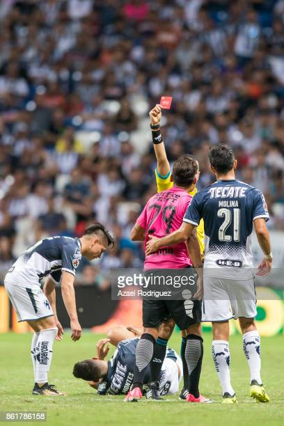 Referee Eduardo Galvan gives a red card to Franco Jara of Pachuca during the 13th round match between Monterrey and Pachuca as part of the Torneo...
