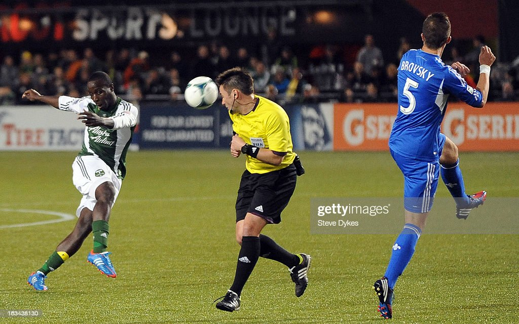 Referee Edwin Jurisevic gets hit in the head by the ball kicked by Andrew Jean-Baptiste #35 of Portland Timbers as Jeb Brovsky #5 of Montreal Impact defends during the second half of the game at Jeld-Wen Field on March 09, 2013 in Portland, Oregon. Montreal won the game 2-1.