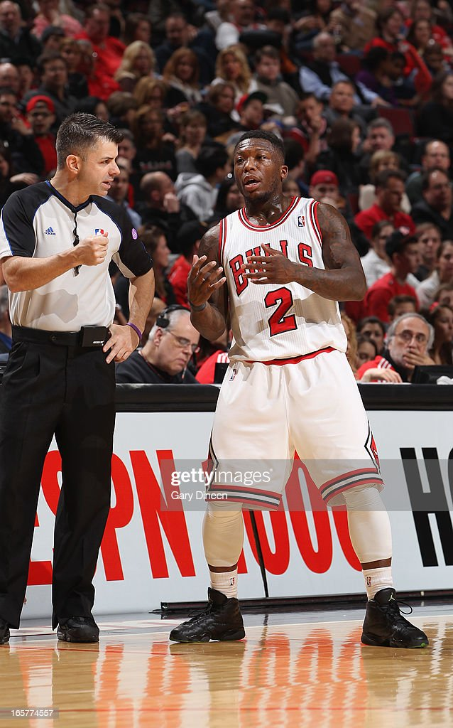 Referee Eli Roe talks with Nate Robinson #2 of the Chicago Bulls during the game against the Orlando Magic on April 05, 2013 at the United Center in Chicago, Illinois.