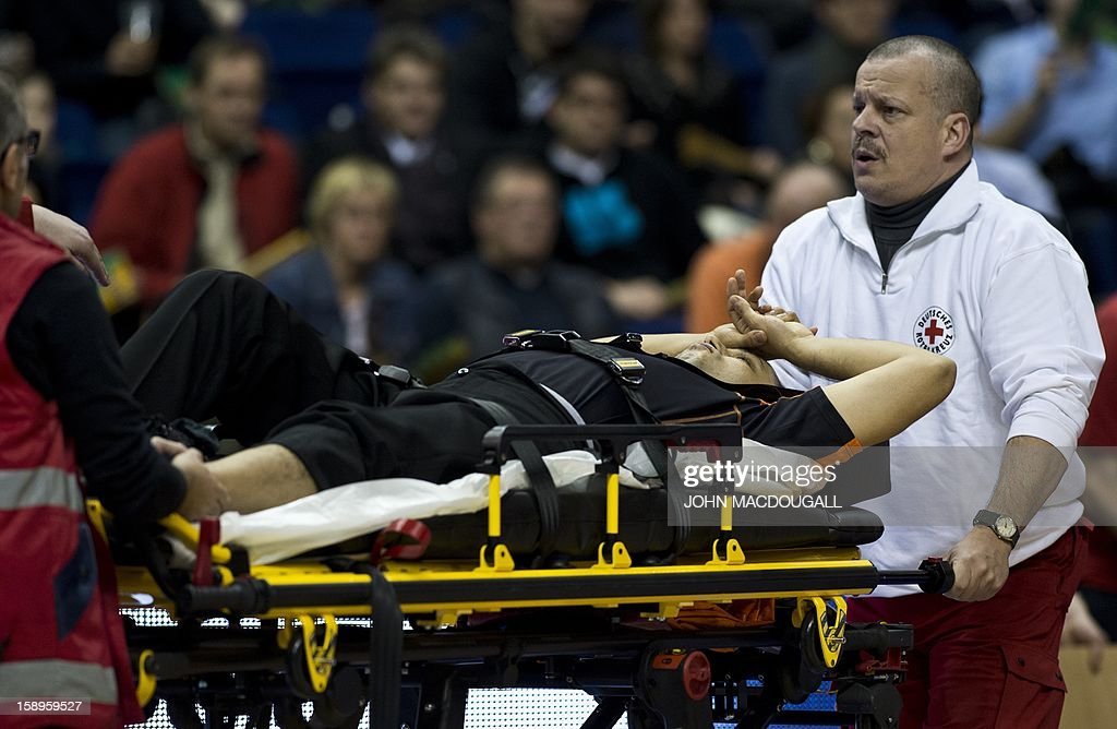 Referee Emin Mogulkoc is stretchered off the court after sustaining a foot injury during the Euroleague top 16 basketball match Alba Berlin (GER) vs ZSKA Moscow (RUS) in Berlin on January 4, 2013. Moscow won 75 to 57. AFP PHOTO / JOHN MACDOUGALL
