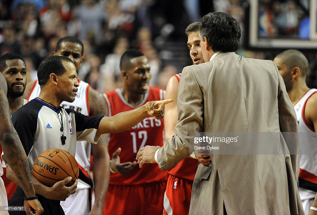 Referee Eric Lewis directs Kevin McHale of the Houston Rockets off the court in the fourth quarter of Game Four of the Western Conference...
