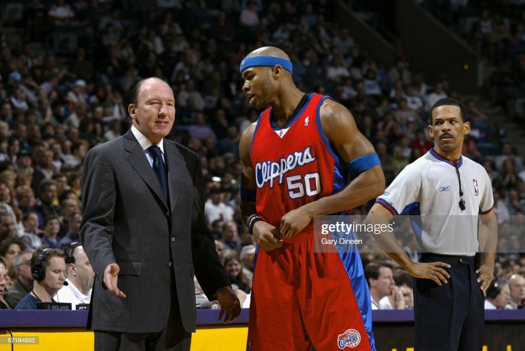 Referee Eric Lewis listens as head coach Mike Dunleavy Sr the Los Angeles Clippers talks to Corey Maggette during the against the Milwaukee Bucks on...