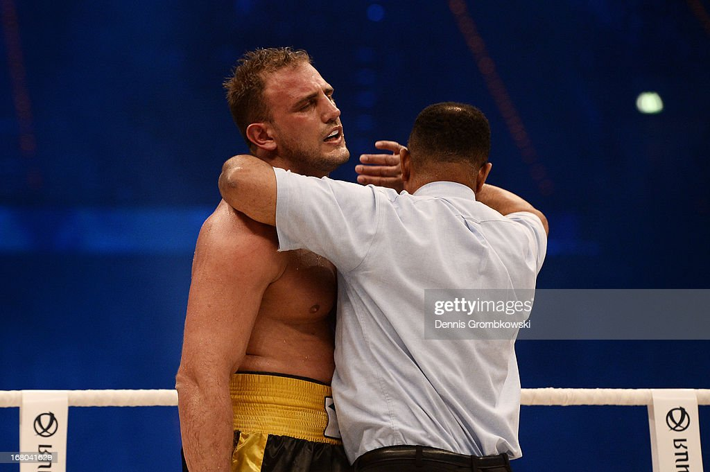 Referee Ernest Sharif helps Francesco Pianeta of Italy to his corner as he stops the bout during the IBF, IBO, WBA, WBO World Championship fight aganst Wladimir Klitschko of Ukraine at SAP Arena on May 4, 2013 in Mannheim, Germany.