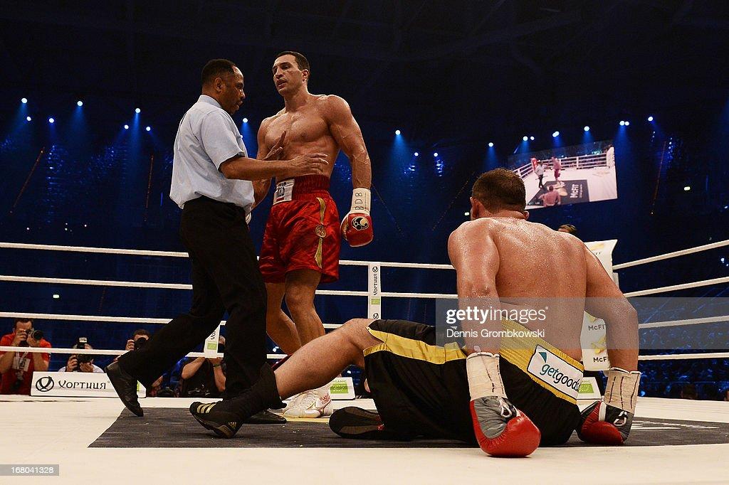 Referee Ernest Sharif steps in after Wladimir Klitschko of Ukraine knocked Francesco Pianeta down during their IBF, IBO, WBA, WBO World Championship fight at SAP Arena on May 4, 2013 in Mannheim, Germany.