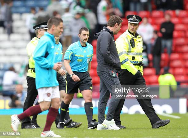 Referee Euan Norris gets a police escort from the pitch after the William Hill Scottish Cup Semi Final at Hampden Park Glasgow
