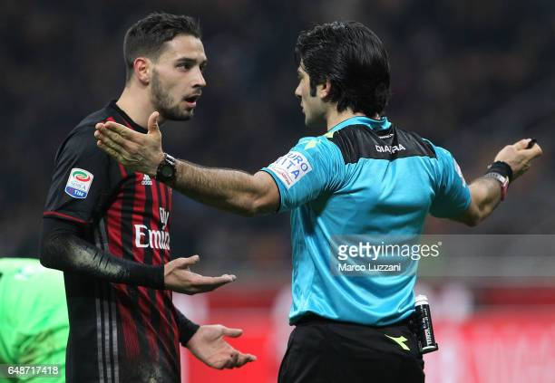 Referee Fabio Maresca disputes with Mattia De Sciglio of AC Milan during the Serie A match between AC Milan and AC ChievoVerona at Stadio Giuseppe...