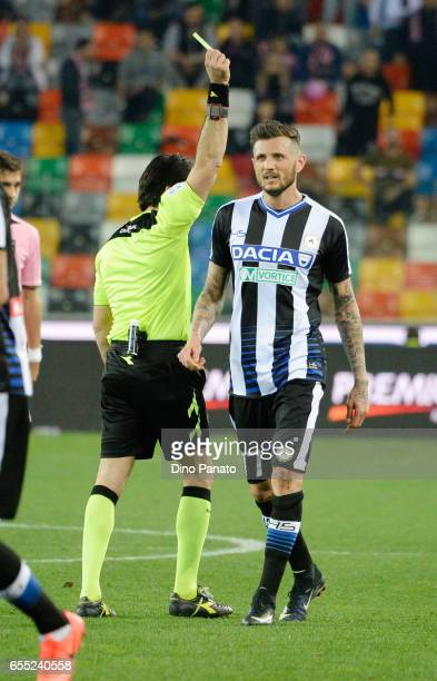 Referee Fabio Maresca shows yellow card Cyril Thereau of Udinese Calcio during the Serie A match between Udinese Calcio and US Citta di Palermo at...