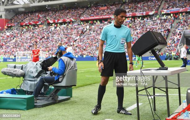 Referee Fahad Al Mirdasi reviewes the VAR footage during the FIFA Confederations Cup Russia 2017 Group A match between Mexico and Russia at Kazan...