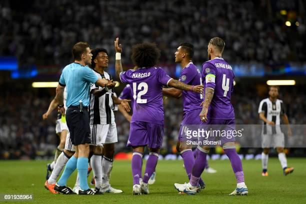 Referee Felix Brych argues with Marcelo of Real Madrid and Casemiro of Real Madrid during the UEFA Champions League Final between Juventus and Real...