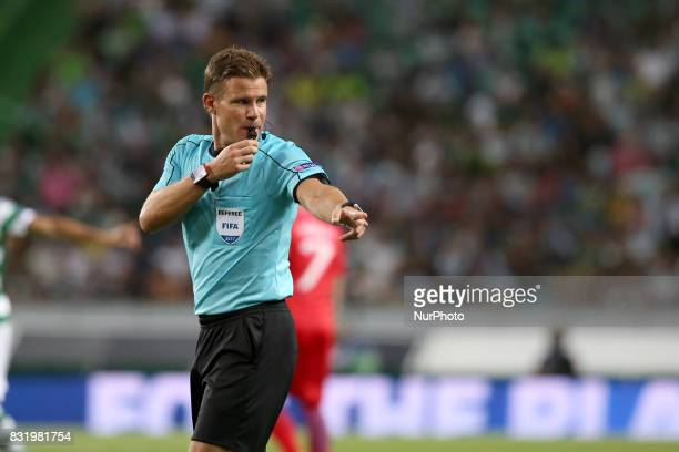Referee Felix Brych from Germany gestures during the UEFA Champions League playoffs first leg football match between Sporting CP and FC Steaua...