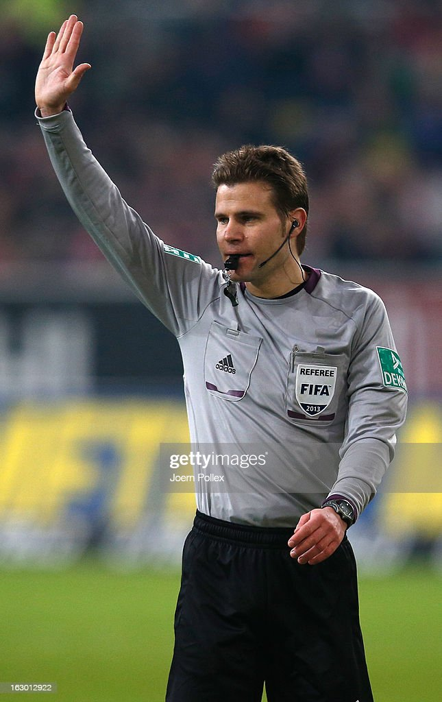 Referee <a gi-track='captionPersonalityLinkClicked' href=/galleries/search?phrase=Felix+Brych&family=editorial&specificpeople=707645 ng-click='$event.stopPropagation()'>Felix Brych</a> gestures during the Bundesliga match between Fortuna Duesseldorf 1895 and 1. FSV Mainz 05 at Esprit-Arena on March 3, 2013 in Duesseldorf, Germany.