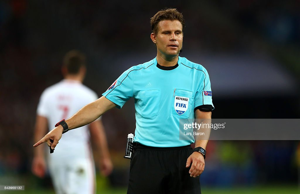 Referee <a gi-track='captionPersonalityLinkClicked' href=/galleries/search?phrase=Felix+Brych&family=editorial&specificpeople=707645 ng-click='$event.stopPropagation()'>Felix Brych</a> gestures during the UEFA EURO 2016 quarter final match between Poland and Portugal at Stade Velodrome on June 30, 2016 in Marseille, France.