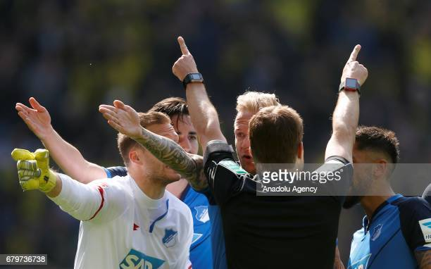 Referee Felix Brych gestures to Kevin Vogt and Oliver Baumann of Hoffenheim during the Bundesliga soccer match between Borussia Dortmund and TSG...