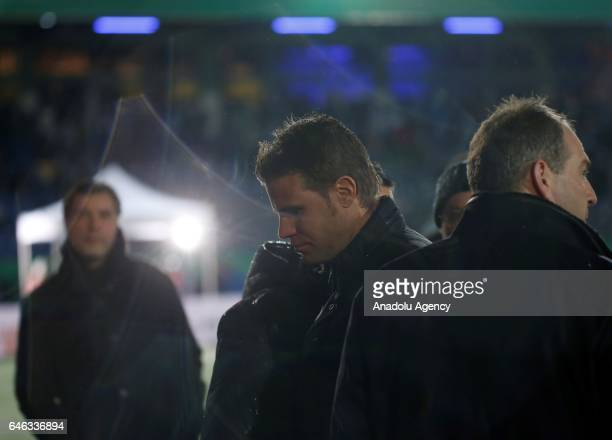 Referee Felix Brych leaves the pitch during heavy snow fall in Lotte Germany on February 28 2017 Sportfreunde Lotte and Borussia Dortmund were...