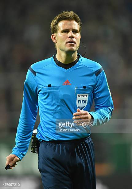 Referee Felix Brych looks on during the Bundesliga match between SV Werder Bremen and 1 FC Koeln at Weserstadion on October 24 2014 in Bremen Germany