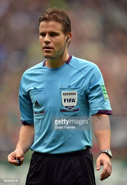 Referee Felix Brych ponders during the Bundesliga match between Werder Bremen and Eintracht Frankfurt at Weserstadion on September 14 2013 in Bremen...
